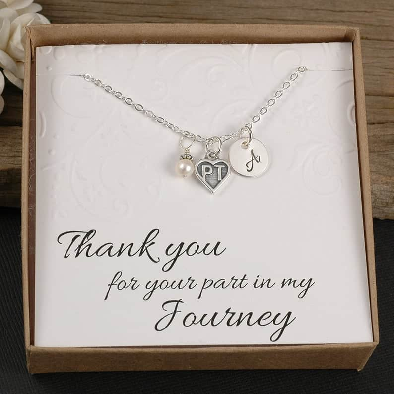 Physical therapist necklace in a box with a thank you note.