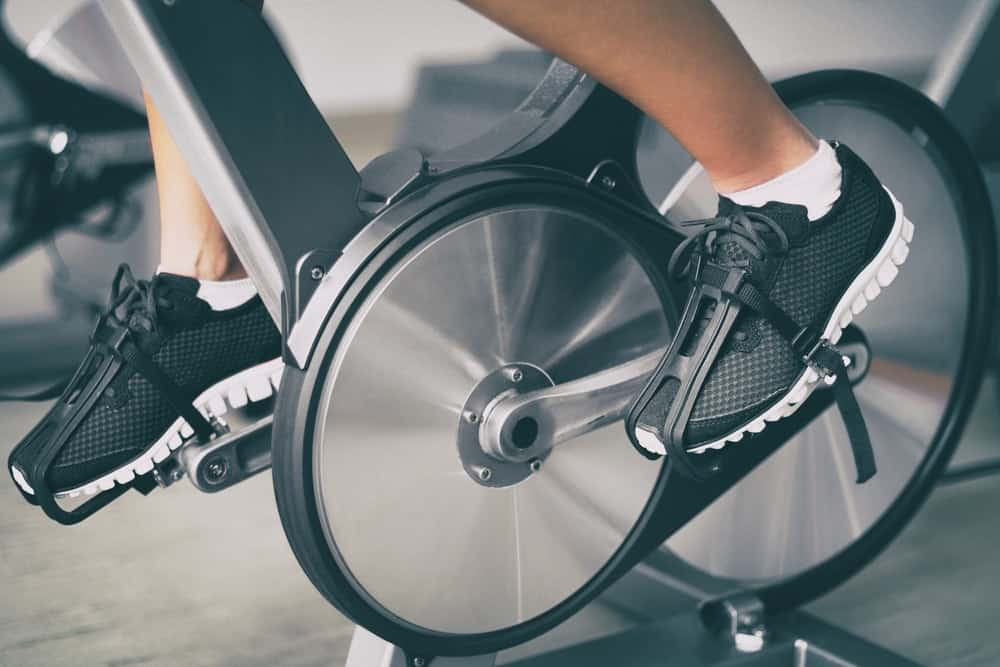 This is a close look at a home bike exercise equipment being used.