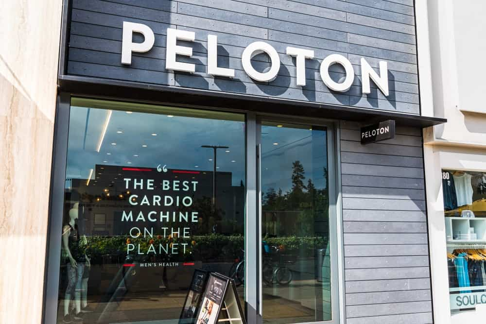 A look at a Peloton storefront with an advertisement on its glass window.