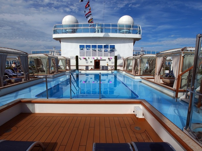 A wide view of a cruise ship from the top deck.