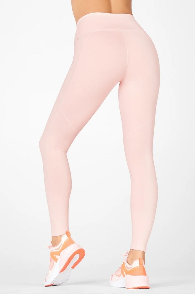 A pair of pink Fabletics Define high-waisted leggings from Fabletics.