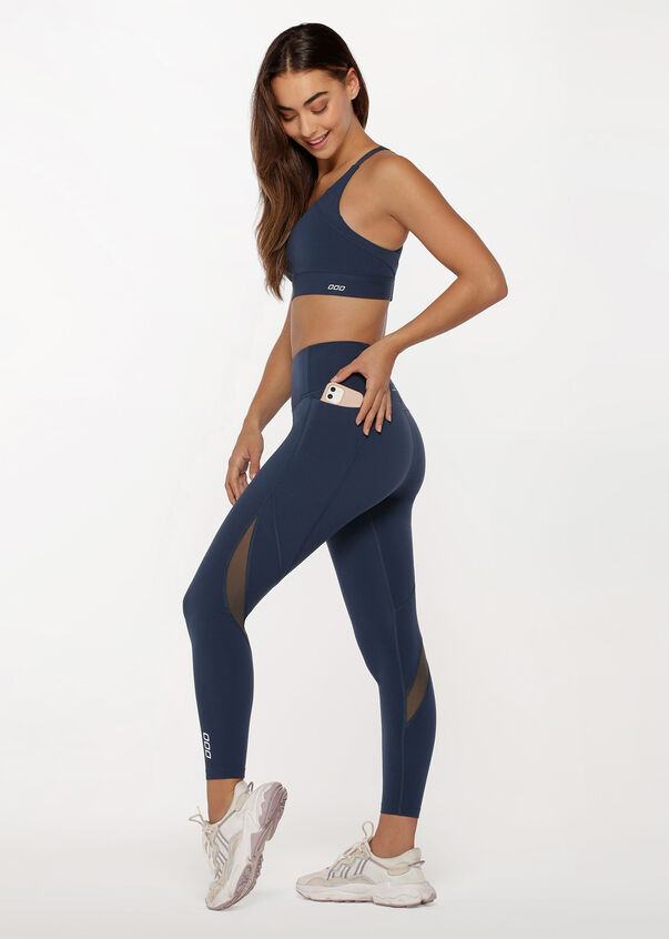 A pair of Empower Phone Pocket Ankle Biter Leggings in Pebble Blue from Lorna Jane.