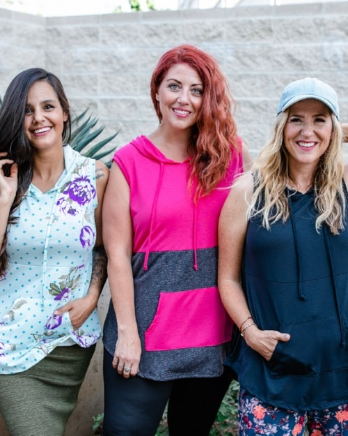 Three women wearing their Brittany hooded tanks in different designs from LuLaRoe.