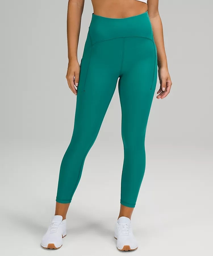 A pair of teal-colored Power Thru High-Rise Crop from Lululemon.