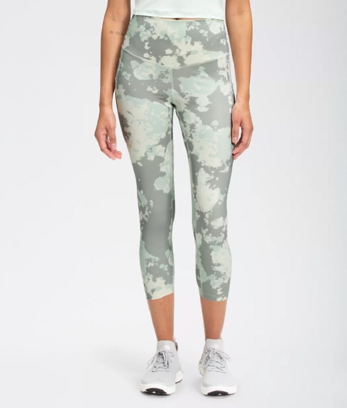 A Women's Motivation High-Rise Pocket Crop in Wrought Iron Surreal Sky Print from Lucy Activewear (The North Face).