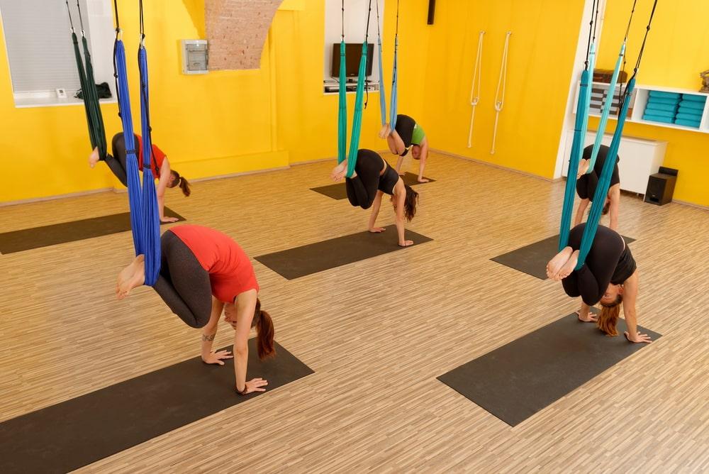 Yoga instructors simultaneously doing their yoga pose for their aerial yoga teacher training.