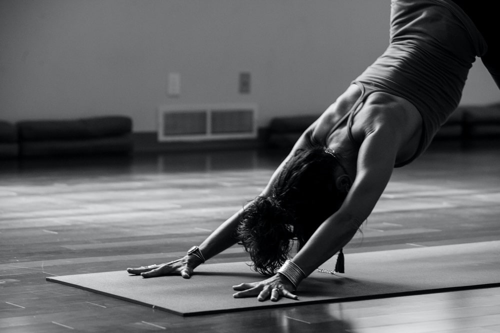 A female yogi doing Downward-Facing Dog Pose as part of her Vin Yin Yoga routine.