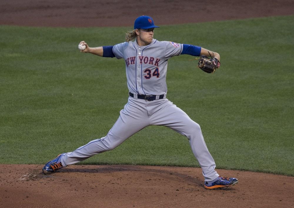 Baseball player pitching.