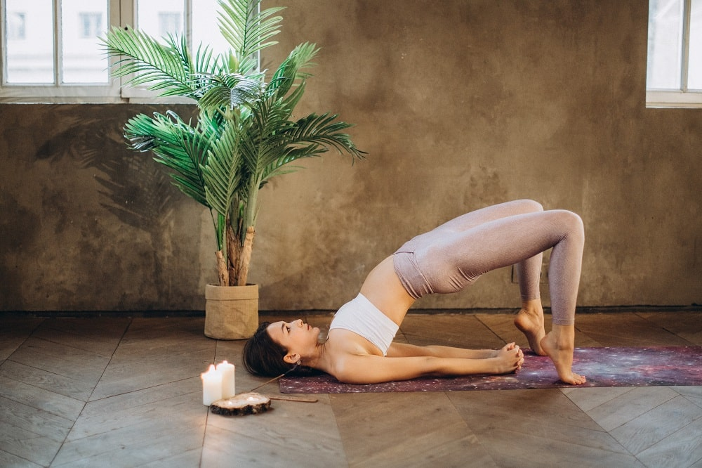 This is a woman doing the dwi pada pitham yoga pose.