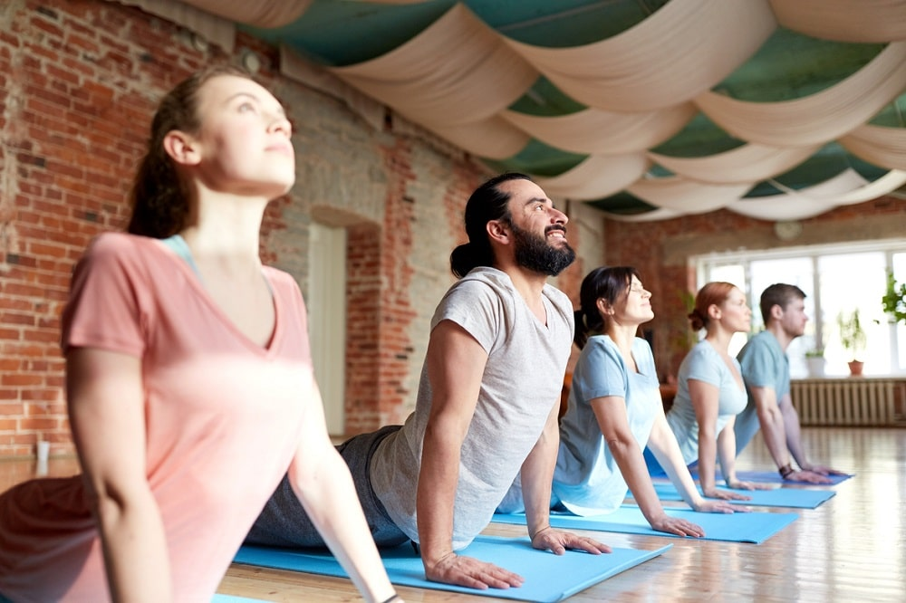 A yoga class doing the cobra pose.