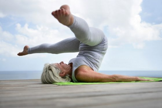 A senior yoga practitioner demonstrating hip strength and flexibility developed from a regular yoga practice.