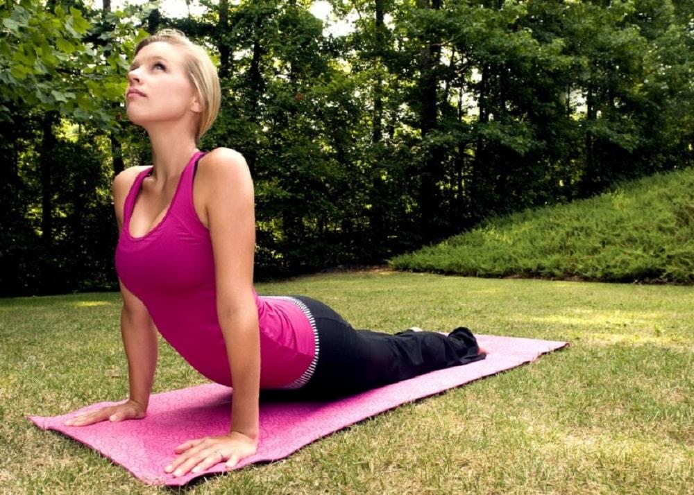 Beautiful woman practicing yoga pose outdoor.