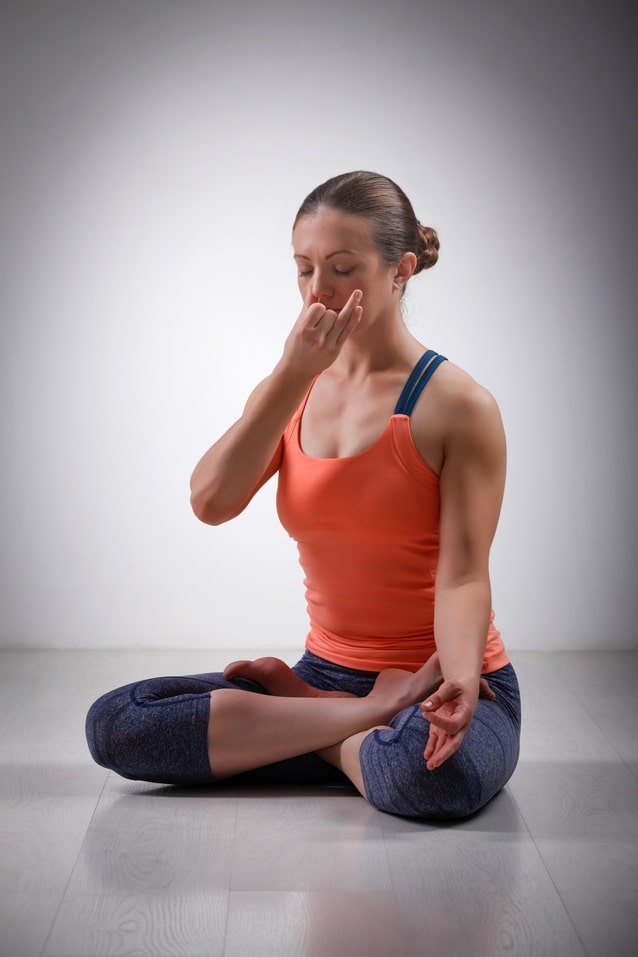 A yoga practitioner using mrigi mudra with her breathing technique to improve focus and clarity.