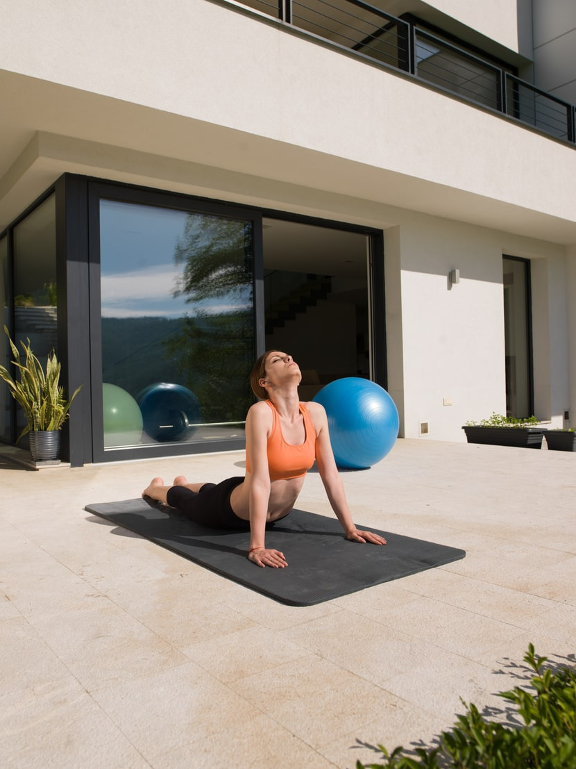 A morning person doing her daily yoga routine at her preferred time of day when she feels most energized.